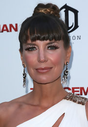 Sandra Vidal's crystal chandelier earrings went perfectly with her updo at the premiere of 'The Iceman.'
