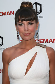 Sandra Vidal styled her hair in a flamboyant braided top-knot with blunt bangs for the premiere of 'The Iceman.'