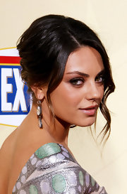 Mila showed off her diamond drop earring while attending the premiere of 'Extract'.