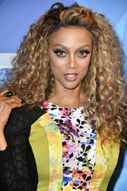 Tyra Banks worked a mega-voluminous curly hairstyle at the premiere of 'America's Got Talent' season 12.