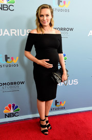 Michaela McManus complemented her maternity dress with black broad-strap heels.