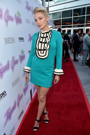 Pom Klementieff kept it playful in a turquoise Gucci mini dress with a ruffle bib and cuffs at the premiere of 'Ingrid Goes West.'