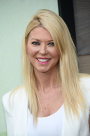 Tara Reid styled her hair into a trendy layered cut for the premiere of 'Bloodline.'