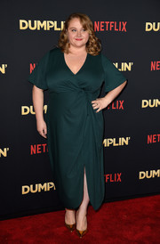 Danielle Macdonald styled her dress with pointy gold pumps.