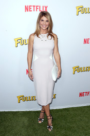 Lori Loughlin opted for a simple sleeveless sheath dress, in pale gray with white waist panels, for the premiere of 'Fuller House.'