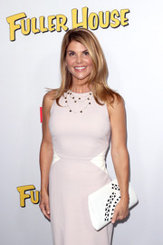 Lori Loughlin attended the premiere of 'Fuller House' carrying a white geometric-print clutch.
