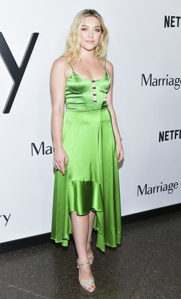 Florence Pugh styled her frock with strappy silver platforms.