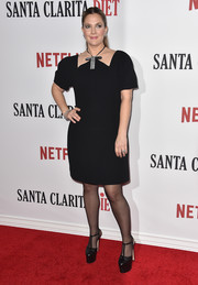 Drew Barrymore complemented her dress with sky-high T-strap platform pumps by Gucci.