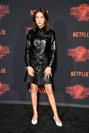 Millie Bobby Brown styled her dress with simple white pumps.