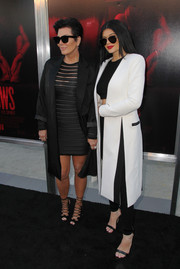 Kylie Jenner layered a white Kimora Lee Simmons coat over a crop-top and leggings for the premiere of 'The Gallows.'