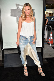 Maria Bello finished off her look with strappy gray sandals.