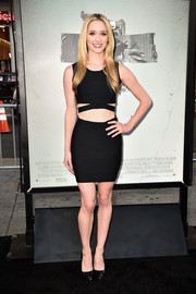Greer Grammer kept the sexy vibe going with a tiny black bandage skirt.
