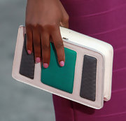 Tika Sumpter attended the premiere of 'What's Your Number?' carrying a colorful clutch with croc paneling.