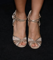Thandie Newton chose these gold lace sandals to go with her totally-classy red carpet look.