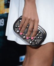 Toks Olagundoye chose a studded clutch to pair with her feminine frock for an unexpected touch of rock 'n roll edge.