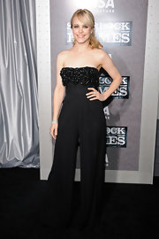 Rachel makes a jumpsuit look elegant in this black piece with a floral adorned strapless bodice.