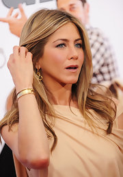 Jen is sporting some lovely rose-cut diamond and gold snake earrings.