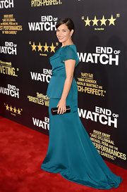 America Ferrera contrasted her pretty teal peplum gown with a hard case oval clutch.