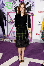 Liz Goldwyn was all dolled up in a frilly pencil skirt with a feathered hem for the premiere of 'Justin Bieber's Believe.'
