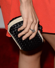 Sabina Akhmedova attended the 'Machete Kills' premiere carrying a black and beige woven satin clutch.