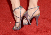 Debby Ryan stepped out in a flirty pair of strappy silver sandals by Stuart Weitzman at the 'Machete Kills' premiere.