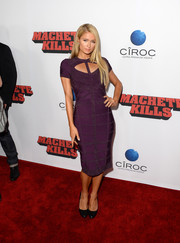 Paris Hilton showed off her slim physique in a body-con purple cutout dress during the 'Machete Kills' premiere.