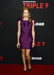 Teresa Palmer got all dolled up in a purple Lanvin mini dress with a ruffled back for the 'Triple 9' premiere.
