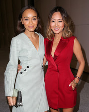 Ashley Madekwe kept it classy with this metallic clutch and coat dress combo at the premiere of 'Dior & I.'