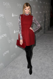Jaime King matched her dress with a red leather clutch, also by Dior.