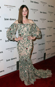 Elle Fanning was boho-glam in a floral-embroidered off-the-shoulder gown by Marchesa during the 'Lowdown' premiere.