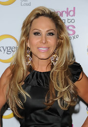 Adrienne Maloof attended the premiere of 'The World According to Paris' wearing her hair in streaked waves.
