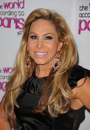 Adrienne Maloof's fancy gold and gemstone chandelier earrings added major glitter to her look during the premiere of 'The World According to Paris.'