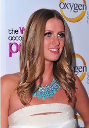 Nicky Hilton paired her cocktail dress with a bold turqouise statement necklace.