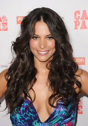 Genesis Rodriguez had her locks teased and curled for a movie premiere.