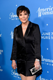 Kris Jenner paired an embroidered leather clutch by Dior with a black tux dress for the premiere of 'American Woman.'