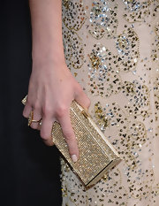 Adrianne Palicki accessorized her stunning beaded gown with an equally sparkly and stunning gold crystal clutch.