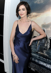 Anne Hathaway styled her sultry gown with a charming star-embellished bracelet ring for the 'Interstellar' premiere.