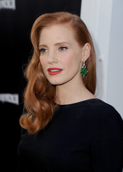 Jessica Chastain accessorized with a stunning pair of Fred Leighton dangling gemstone earrings for added color and allure.