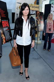 Lynn took her ensemble from day to night with a sequined cropped blazer.