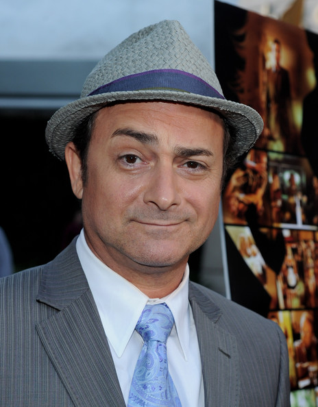 Kevin Pollak paired his grey suit with a classic fedora hat.