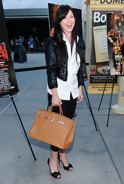 Lynn Collins paired her red carpet look with a coveted Hermes bag.