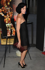 Selma went for a classic look in a strapless Stella McCartney dress and patent heart-shaped peep toe pumps.