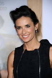 Charcoal smokey shadow was used to enhance Demi Moore's hazel eyes.
