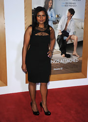 Mindy wore a sultry little black dress with lace inserts at the neckline.