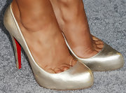 Cheryl Burke chose a pair of gold pumps for her look at the premiere of 'Pain & Gain.'