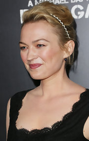 Sophia Myles chose a messy pinned updo for her effortlessly chic look at the premiere of 'Pain & Gain.'