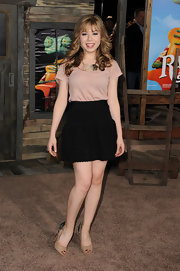 Jeanette McCurdy paired her flouncy skirt and blush blouse with studded peep toe pumps.