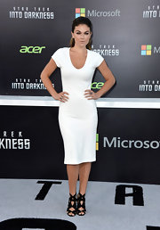 Serinda's scoopneck fitted white frock gave her a totally sexy feminine look at the the 'Star Trek Into Darkness' premiere in Hollywood.