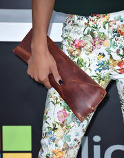 Jessica opted for a brown leather oversized clutch for her carry all at the premiere of 'Star Trek Into Darkness.'
