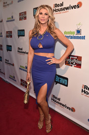 Alexis Bellino styled her racy outfit with strappy gold heels.